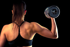 Fitness girl - attractive young woman working out with dumbbells Stock Photos