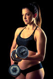 Fitness girl - attractive young woman working out with dumbbells Royalty Free Stock Photography