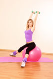 Fitness girl and ball Royalty Free Stock Images