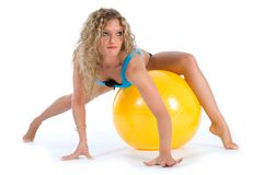 Fitness girl and ball Stock Photos