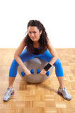 Fitness girl with ball and weights Stock Photography
