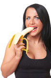 Fitness girl with banana isolated on white Royalty Free Stock Photo