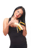 Fitness girl with banana isolated on white Royalty Free Stock Image