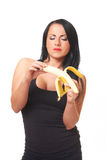Fitness girl with banana isolated on white Royalty Free Stock Photography