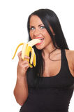 Fitness girl with banana isolated on white Stock Photography