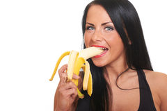 Fitness girl with banana isolated on white Royalty Free Stock Images