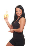 Fitness girl with banana isolated on white Stock Image