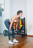 Fitness girl with a barbell, coach. Fitness girl training with a barbell, the coach. The concept of sport, health Stock Photos