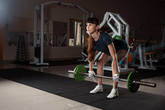 Fitness girl with a barbell in the gym Stock Image