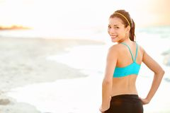 Fitness girl on beach Stock Image