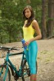 Fitness girl with bike Stock Image