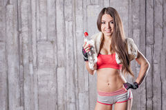 Fitness girl with bottle of water Royalty Free Stock Image