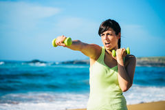 Fitness girl boxing with dumbbells Royalty Free Stock Images