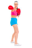 Fitness girl in boxing gloves punching Royalty Free Stock Photo