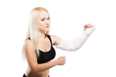 Fitness girl with a broken arm Royalty Free Stock Photo
