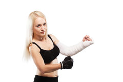 Fitness girl with a broken arm Royalty Free Stock Photography