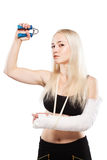 Fitness girl with a broken arm Royalty Free Stock Photos