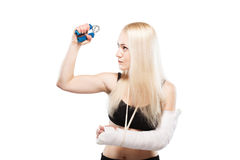 Fitness girl with a broken arm Stock Images
