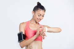 Fitness girl checking workout progress on smart watch Stock Photos