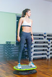 The fitness girl on the core platform. Concept health, sports Stock Photography