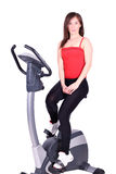 Fitness girl with cross trainer Royalty Free Stock Photo