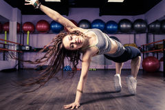 Fitness girl dancing zumba workout in gym. Weight loss activity exercises Royalty Free Stock Photo
