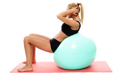 Fitness girl doing abs on a gym ball Royalty Free Stock Photography