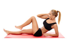 Fitness girl doing abs Stock Photos