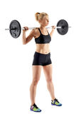Fitness girl doing barbell squats Stock Photos