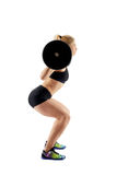 Fitness girl doing barbell squats Royalty Free Stock Image