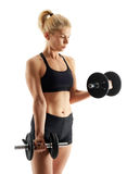 Fitness girl doing biceps curl Royalty Free Stock Image