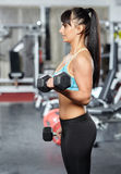 Fitness girl doing biceps workout Stock Images