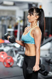 Fitness girl doing biceps workout Royalty Free Stock Images