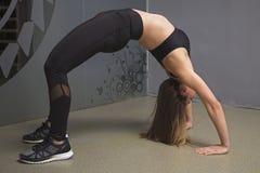 Fitness girl doing Bridge pose. In the gym Stock Photos