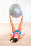 Fitness girl doing exercises with fitness ball Royalty Free Stock Image