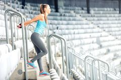 Free Fitness Girl Doing Fitness Exercises And Working Out On Stadium Stairs. Jogger On Morning Training, Healthy Lifestyle Concept Stock Photo - 53740610