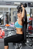 Fitness girl doing shoulder workout Royalty Free Stock Photography