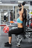 Fitness girl doing shoulder workout Royalty Free Stock Photo