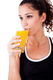 Fitness girl drink a fresh juice Royalty Free Stock Image