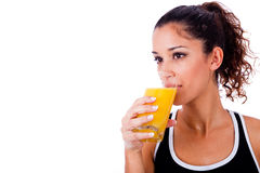 Fitness girl drinking fresh juice Royalty Free Stock Photography