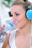 Fitness girl drinking water Royalty Free Stock Images
