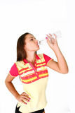 Fitness girl drinking water isolated Stock Image