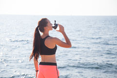Fitness girl drinks water sport training. 1 Royalty Free Stock Photos