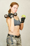Fitness girl with dumbbell Stock Photography