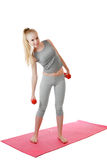 Fitness girl with dumbbells Royalty Free Stock Photography