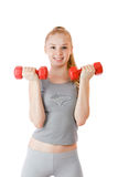 Fitness girl with dumbbells Stock Photography