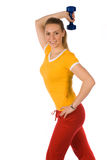 A fitness girl with dumbbells. A blonde girl warming up with dumbbells Royalty Free Stock Image