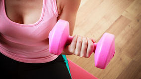 Fitness girl with dumbbells doing exercise Stock Image