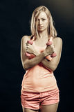 Fitness girl with dumbbells flexing muscles in gym Royalty Free Stock Photography
