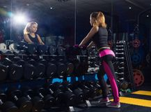 Girl with dumbbells. Stock Photography